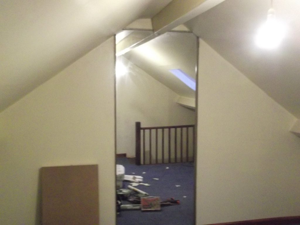 Back Wall Of Loft Room With Floor To Ceiling Mirror