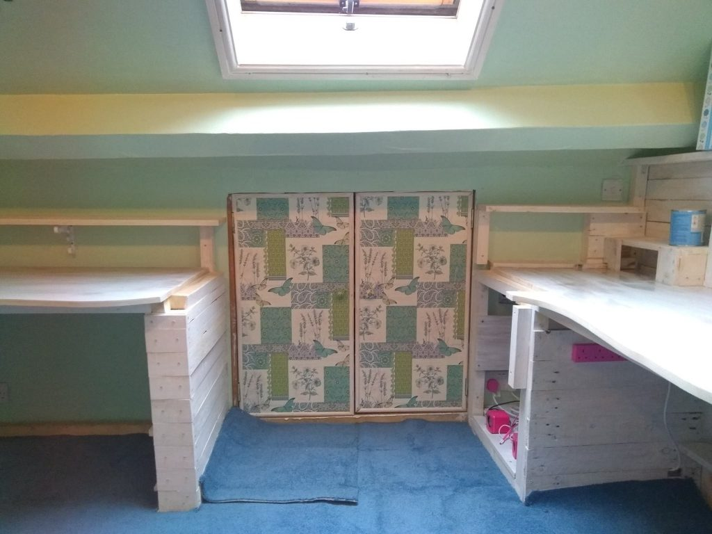 Doors To Loft Storage Covered With Wallpaper