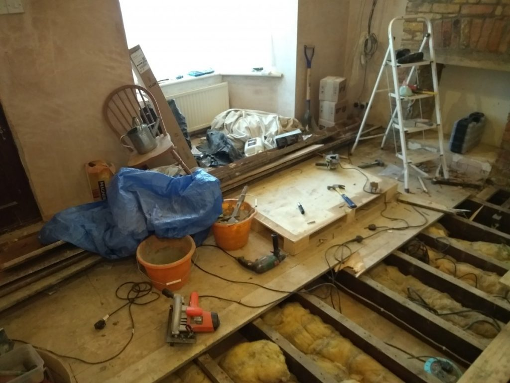 Old Floorboards being pulled up So That The New Flooring Can Be Fitted