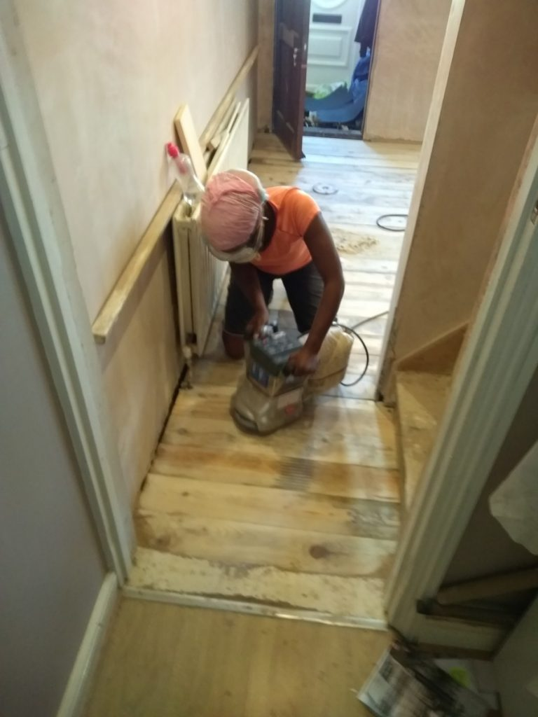 Sanding The Floorboard To An Even Finish Ready For Staining