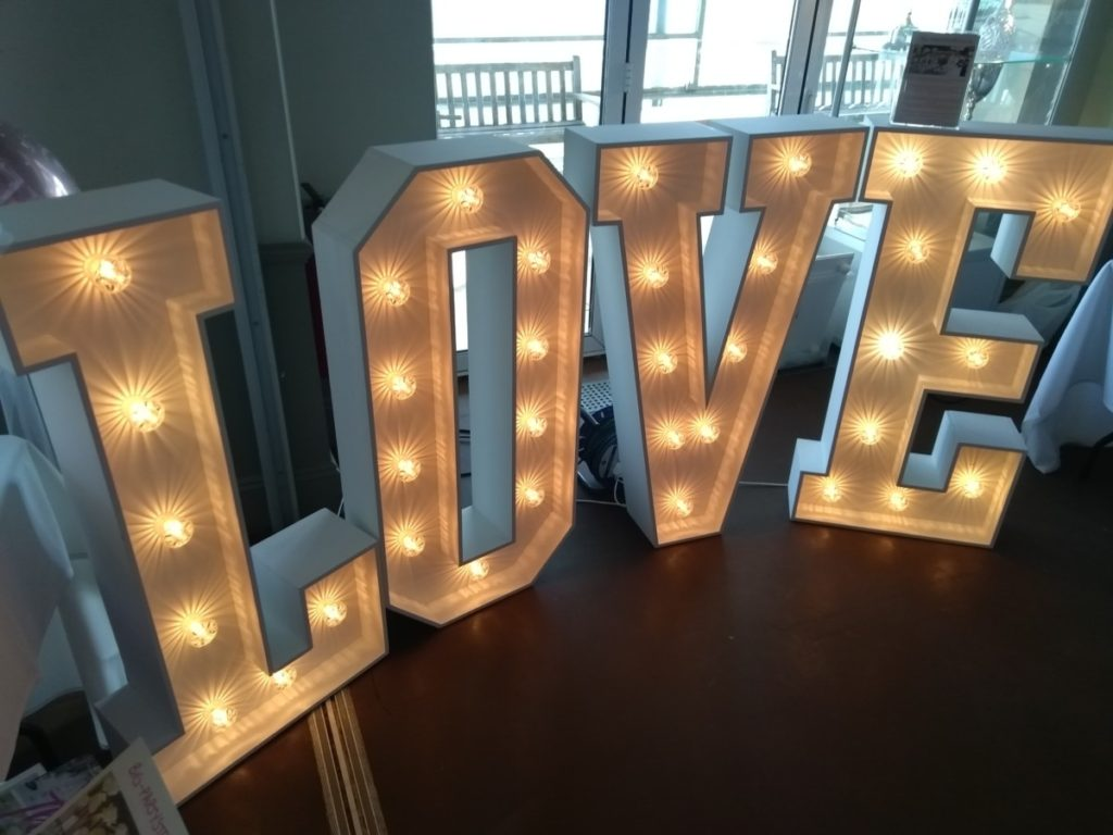 Love Sign Made Of Wood With Light Bulbs.