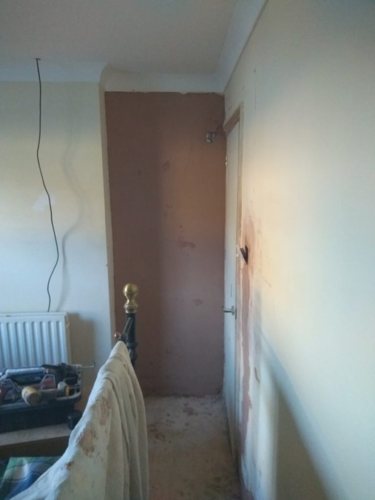 plastering the front bedroom and repairing the lower walls