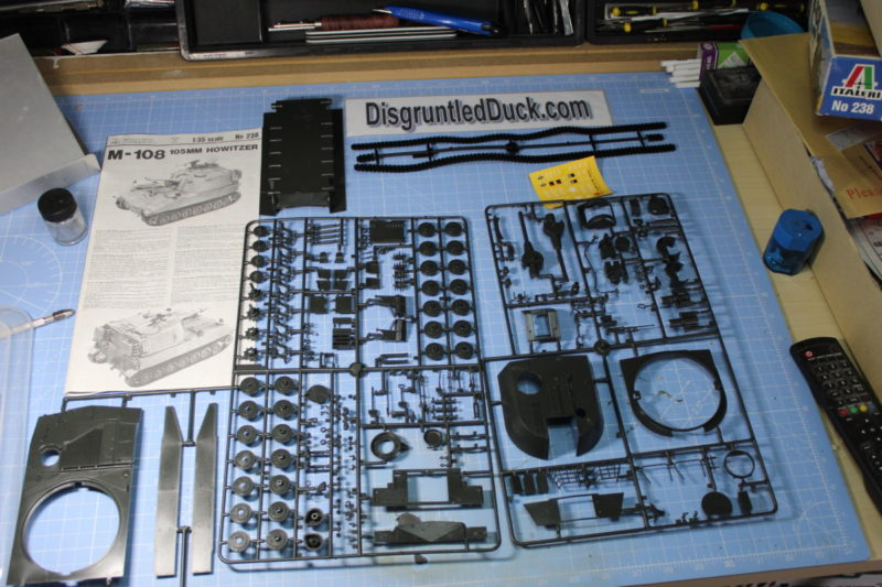 All The Parts Of The Italleri M-108 105MM Howitzer Laid Out On The Workbench
