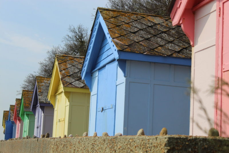 Old Brightly Painted Beach huts in Folkstone