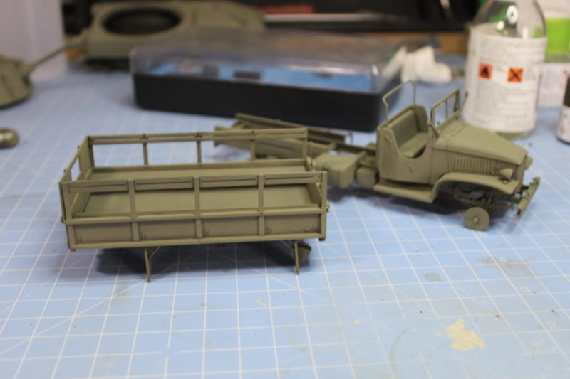 Coated The Cargo Truck with a lightened olive drab