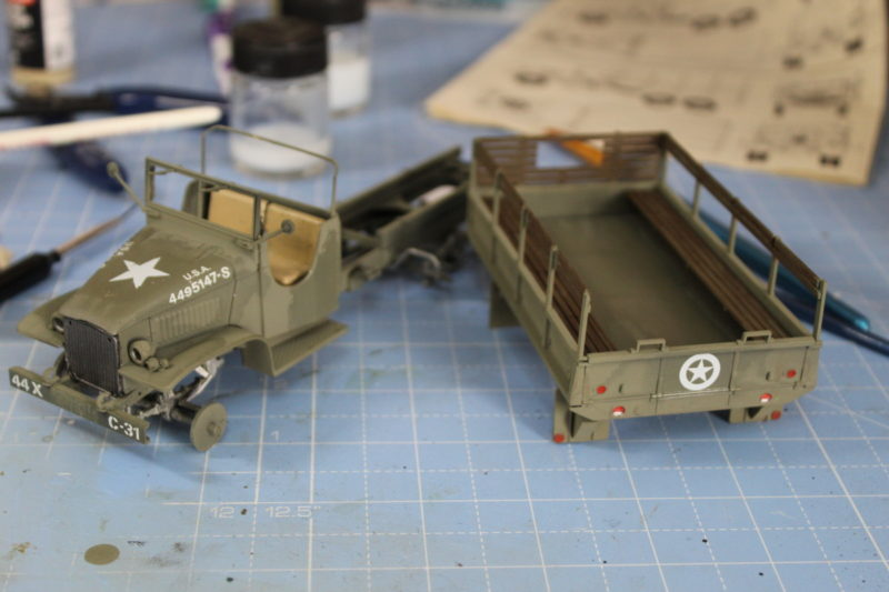 Painting the details on to the cargo truck before washes