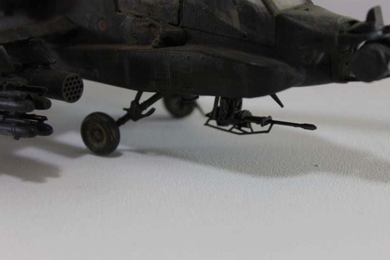 The Front Machine Gun And Wheels On The Apache Helicopter Scale Model.