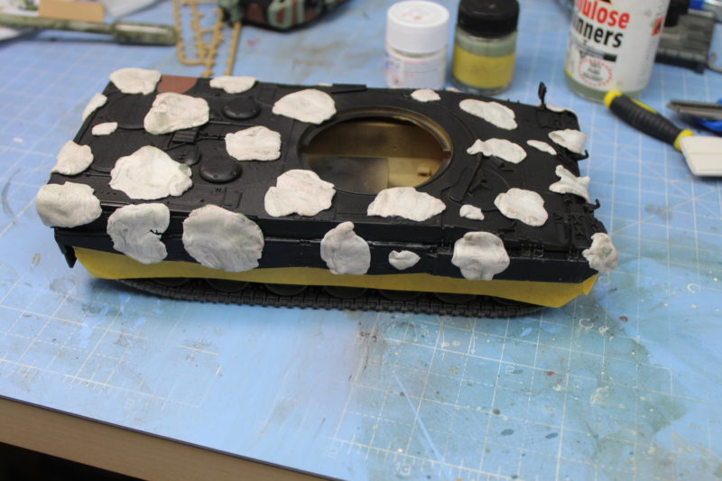 The Scale Model Tank Hull Is Masked For Painting