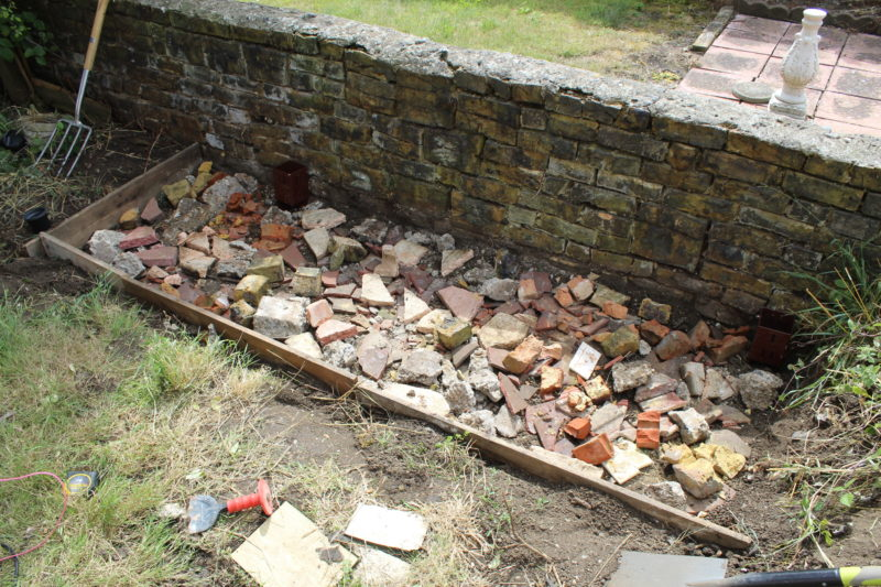 Filled The Dug Out BBQ Area With Rubble Before Pouring In The Concrete